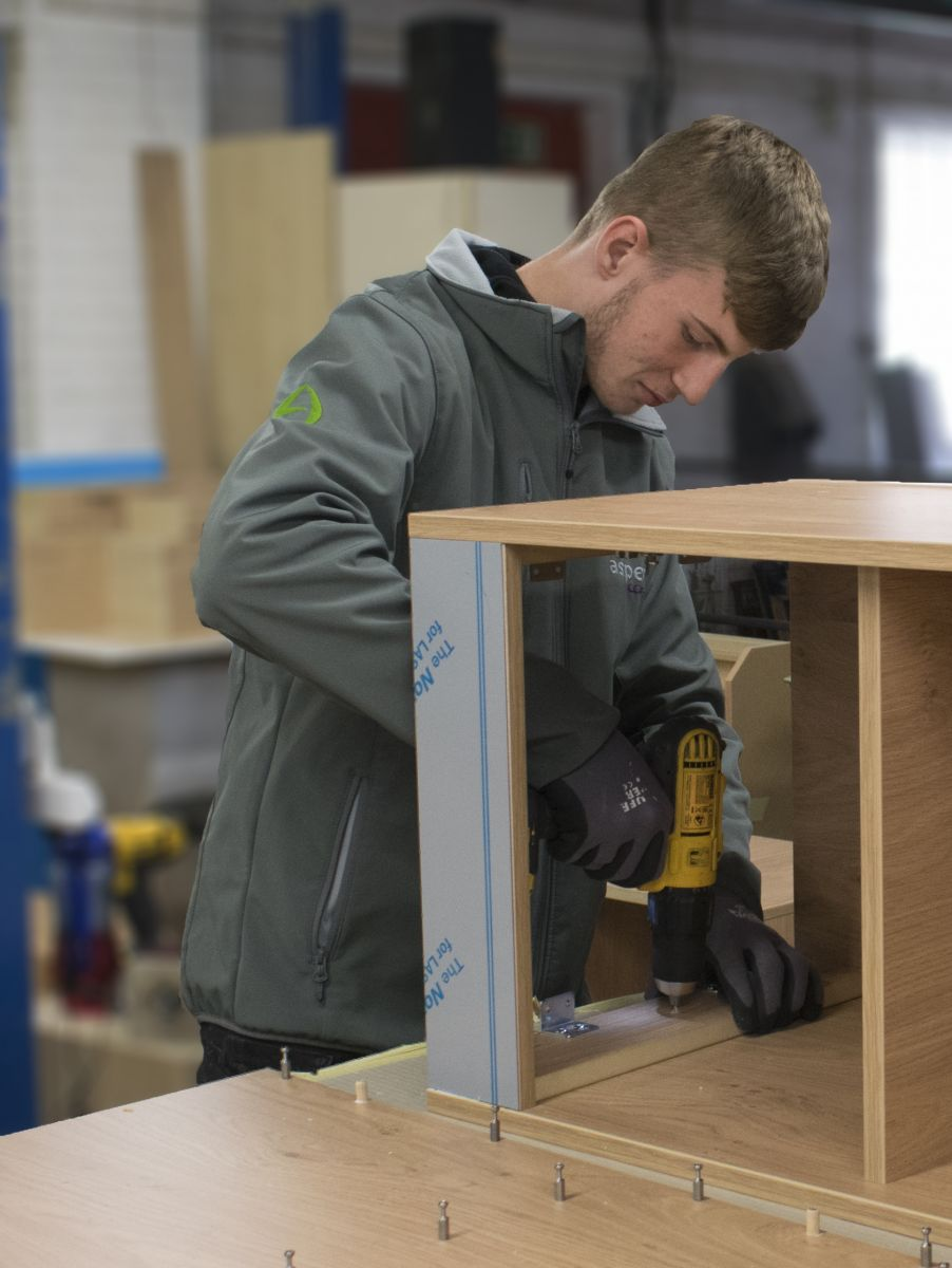 Aspen Concepts apprentice fixing a screw