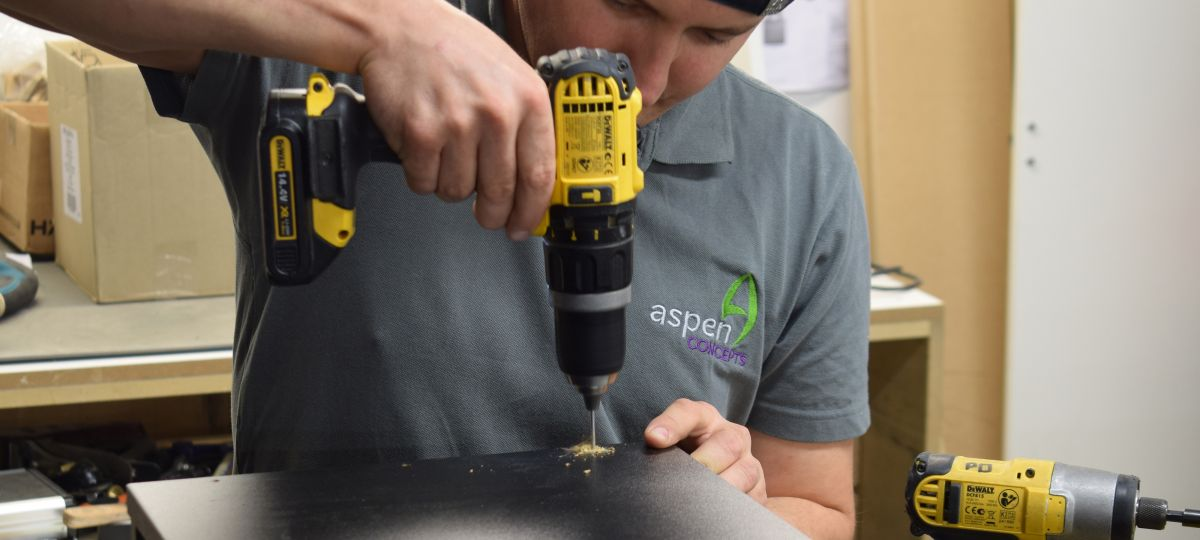 drilling a hole in cabinet manufactured by Aspen Concepts
