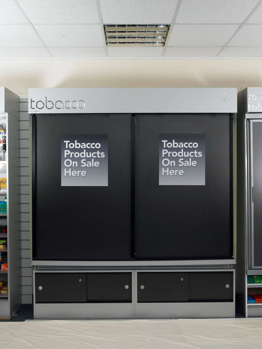 tobacco and cigarette cabinet with self closing doors