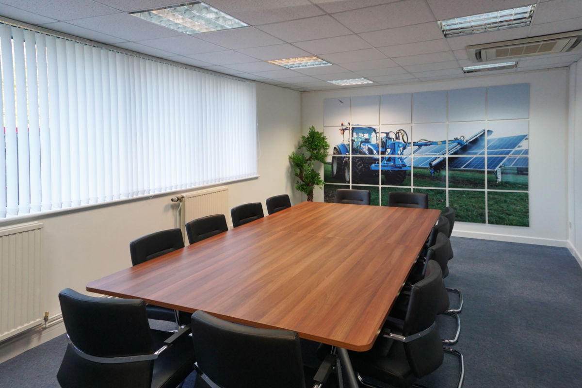 Boardroom table and graphic display installed by Aspen Concepts