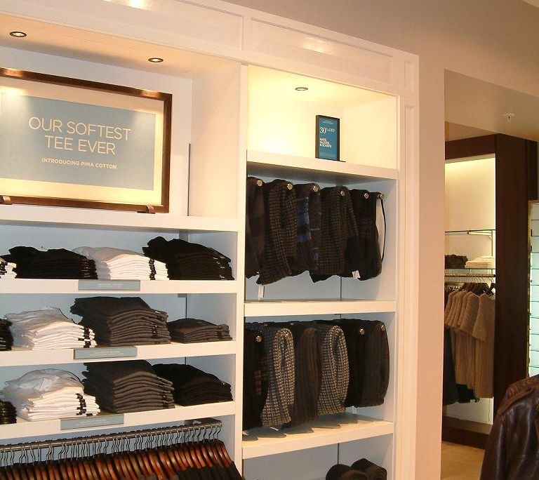 white shelving installed by Aspen Concetos for Banana Republic Covent Garden