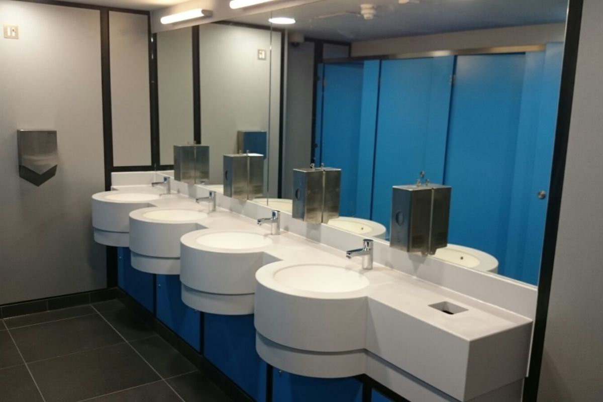 vanity units and toilet cubicles in blue
