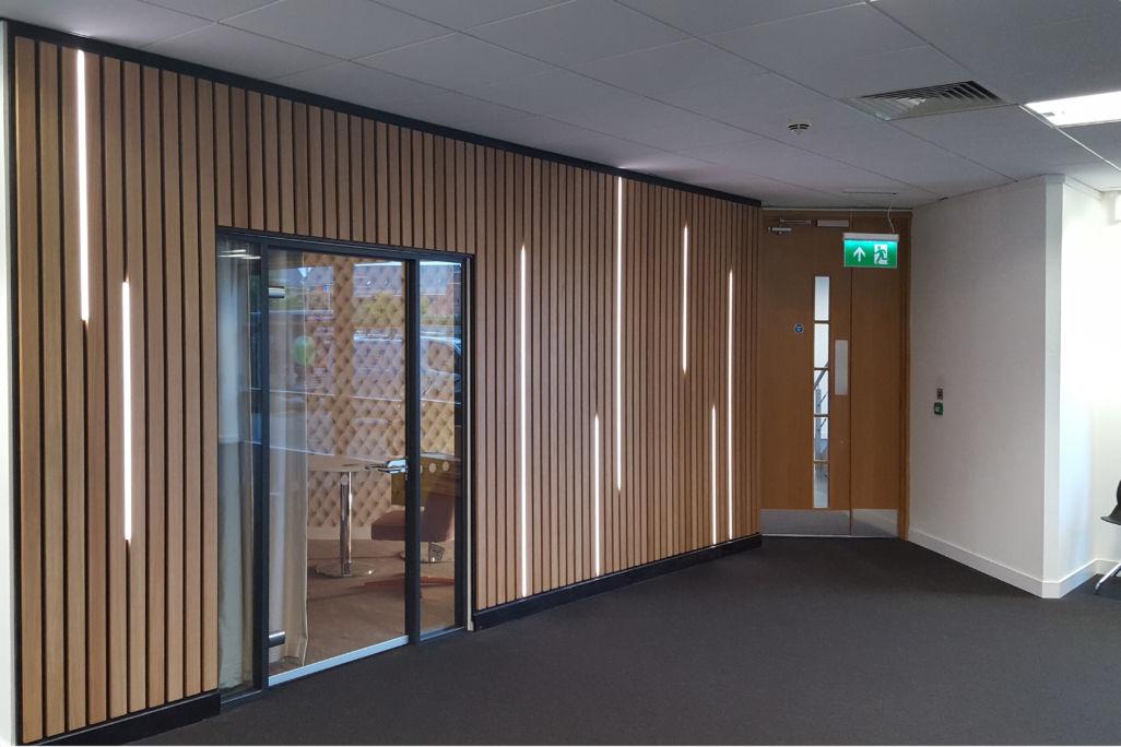 office interior Rocket X Newcastle vertical LED lights in Oak panelling