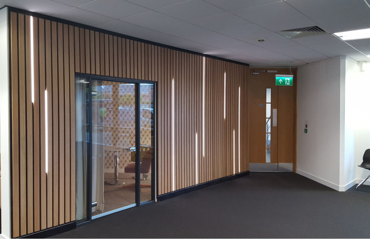 office interior Rocket X Newcastle vertical LED lights in Oak panelling