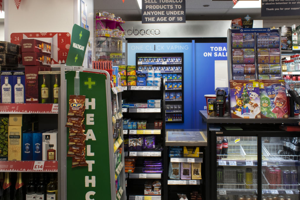 Imperial Tobacco Blu Vaping POS in door behind one stop counter