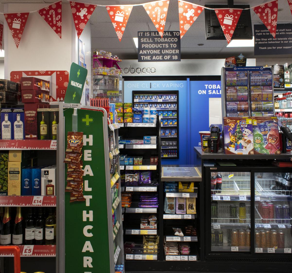 Imperial Tobacco Blu Vaping POS in door behind one stop counter
