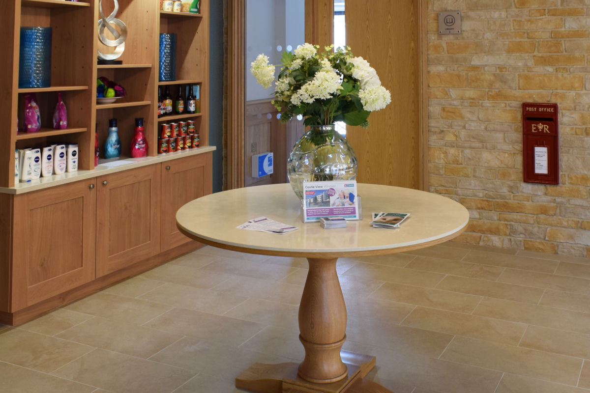 bespoke table and shelves for retirement home reception Windsor castle view