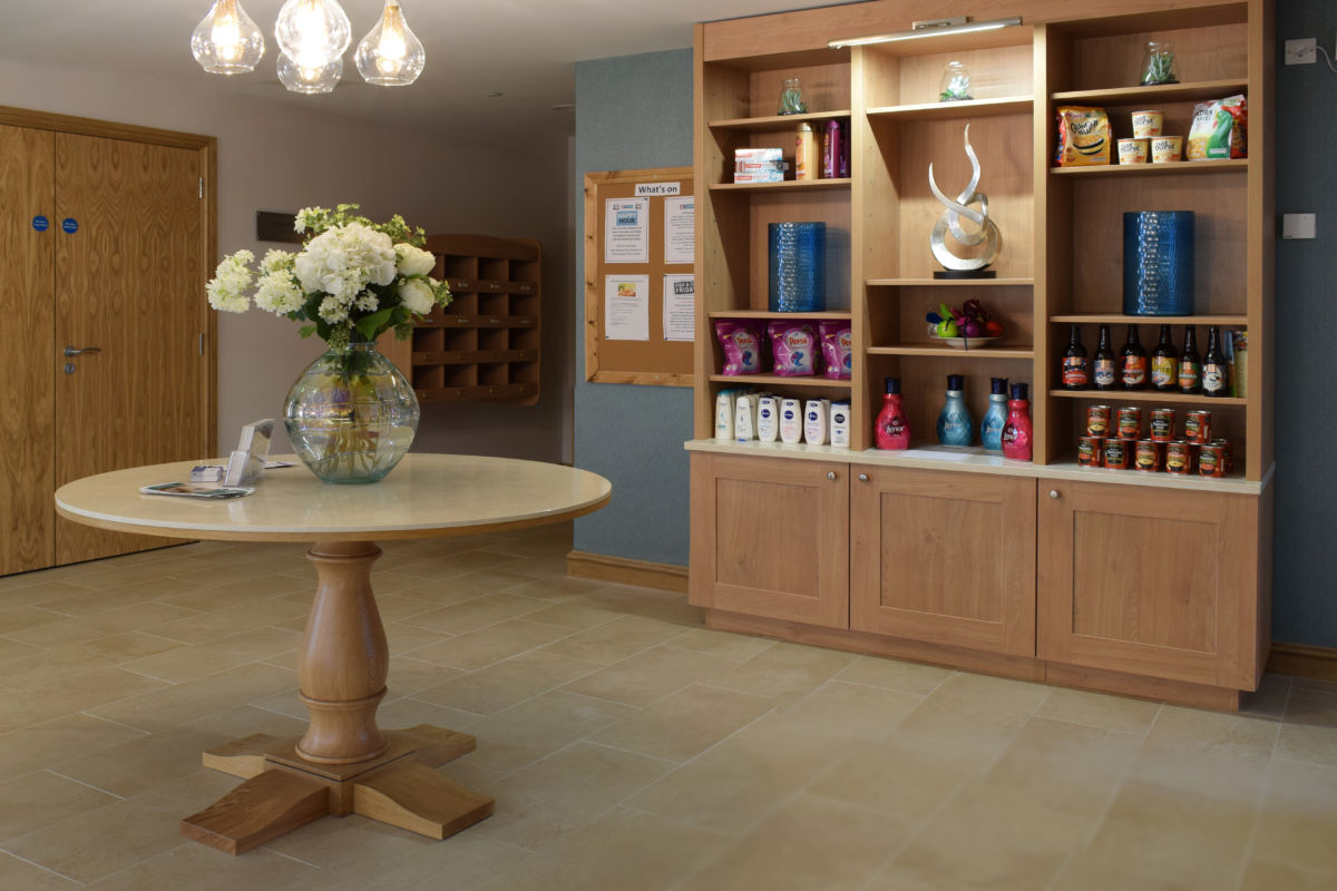 bespoke joinery table and shelves - retirement home reception