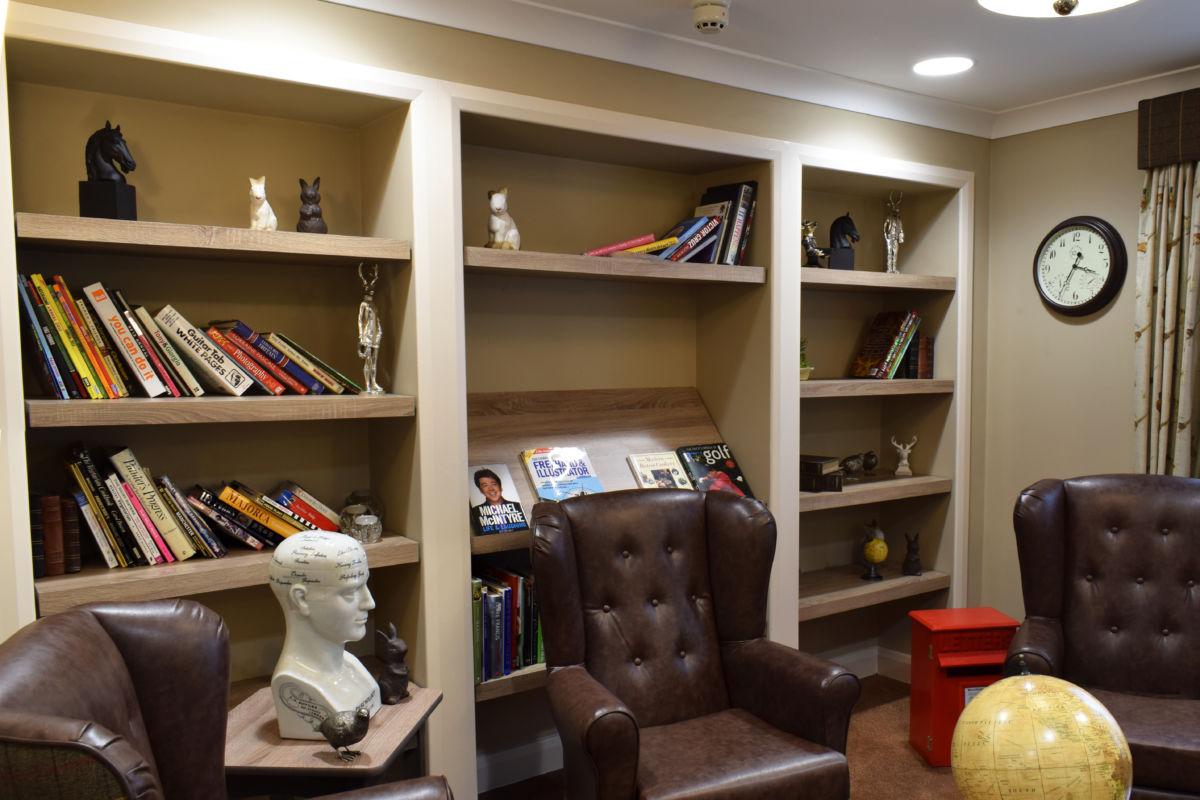 Mountbatten Grange care uk home library shelving 2